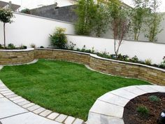 A sweeping curve is often the best line to take for a Raised Planting Bed. Smart Gardening for Small spaces. Garden Mum, Garden Beds, Brick Planter, Front Yard Landscaping, Landscaping Ideas, Small Garden Design, Garden Features, Small Gardens, Garden Planters