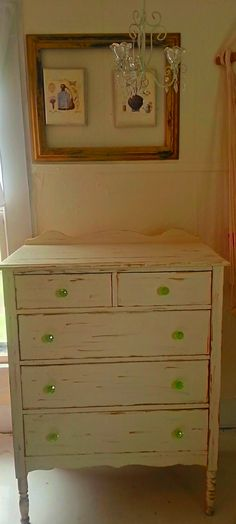 Refurbished solid chester drawers naturally distressed, painted Antique White with gold leaf accents. New green vintage handles.