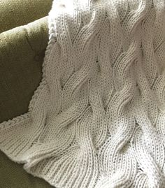 Free Knitting Pattern for Easy Reversible Moguls Blanket - Knitting these all over cables in a ribbed pattern makes this easy blanket completely reversible. Designed by Trisha Mitberg. Rated easy by Ravelrers. Quick knit in super bulky yarn.
