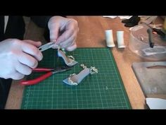 Making polymer clay soles using a pattern and making metal stiletto heels for the soles. For an index of all the Fashion Doll Shoes Tutorials listed accordin...