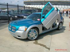 Nopi Nationals - Motorsports Supershow 2005 Dodge Magnum with double gull winged doors & Rolls with Lambo doors | Cool cars | Pinterest | Cars Hummer truck ...