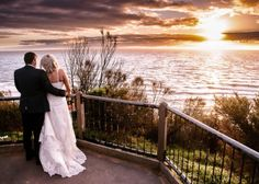 Bride and groom with sunset in the background