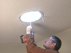 DIYNetwork.com remodeling expert Paul Ryan demonstrates how to install a tube skylight in a living room ceiling. Learn how a solar tube can really brighten up a dark space.