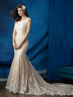 With a perfect train and slight V-back, this lace sheath is subtle but impactful // Allure Bridals 9354