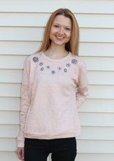Embellished Luxe Pale Pink Sweater Get fancy with these floral embellishments on either a pale pink or light gray luxe sweater. Tis the season to subtly sparkle! White Barn Boutique