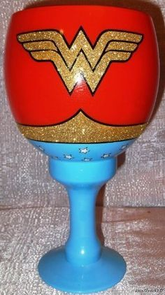 DC Comics WONDER WOMAN Logo Jumbo 40oz Glass w/ Gold Glitter Drinking GOBLET by Main Street 24/7, http://www.amazon.com/dp/B006F8ZLNC/ref=cm_sw_r_pi_dp_mP.Zpb0G32FKK
