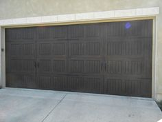 Wood grain painting on steel garage door 16x7 wayne for 18x8 garage door