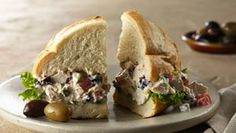 GREEK CHICKEN SALAD SANDWITCH!!!  + a million other verisons of chicken salad, asian, avocado, bastil tomatoe, and many more. Will need to adapt but good idea starters.