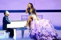 Blooming lovely! Ariana looked like a princess as she sat atop a piano in a sparkling top ...
