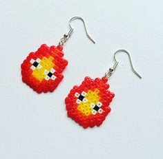 Super-cute Calcifer hama bead earrings, inspired by Studio Ghiblis Howls Moving Castle!  Handmade using mini Hama / Perler beads with