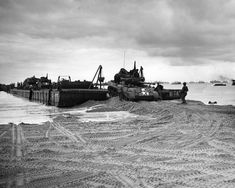Tanks debarking off the Rhino ferry onto the beach of Normandy.