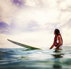 she is a mermaid and her surfboard is her stallion. That's what it looks like!