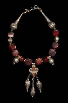 by Marion Hamilton | Necklace; 19th century square carnelian beads cut in Idar Oberstein with a Yomut amulet and Yemeni silver. || POR