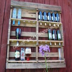 Wine/liquor rack made out of an old wooden pallet...I will make this