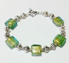 Items similar to Sea colored dichroic glass and silver bracelet on Etsy Sea Colour, Color, Dichroic Glass, Jewels, Trending Outfits, Unique Jewelry, Bracelets, Handmade Gifts, Silver