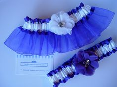 Organza and satin wedding garter set adorned with chiffon flowers with pearl and rhinestone centers.  TheWeddingGarter.com