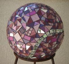mosaic gazing (bowling) ball  http://www.twosistersmosaics.com/rock-n-rollers.html