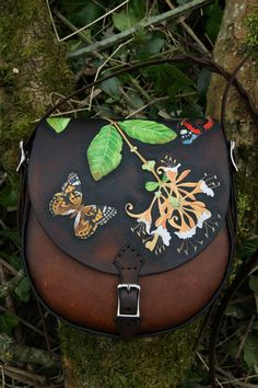 Kennet bag with beautifully detailed honeysuckle and butterflies on warm brown leather