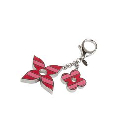 Don't go anywhere without this lovely Louis Vuitton Sweetstripes Flower bag charm  #Repin by https://www.kensington-bespoke.uk - Bringing the #chic and #style of #Kensington High Street direct to your home.