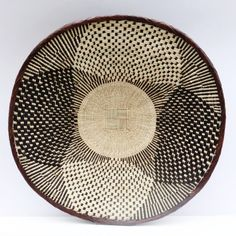 These baskets look beautiful in groups adorning your walls. Binga Baskets are handwoven in Zimbabwe by talented African artisans. Baskets On Wall, Storage Baskets, Wall Basket, Basket Weaving, Hand Weaving, Eclectic Decor, Tribal Art, Boho Decor, Living Room Decor
