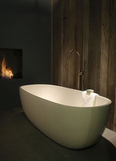 Classic bath, wood panelling and fireplace