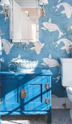 """The """"Derwent Koi"""" wallpaper by Osborne & Little, the blue and white porcelain vessel sink on the blue vanity, the inconspicuous wall-mounted faucet - make me smile!"""