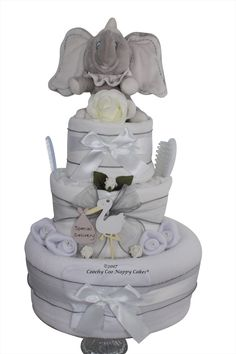 Newborn baby shower nappy cake gift - unisex white design with disney dumbo baby toy. Exclusive by Coochy Coo nappy Cakes