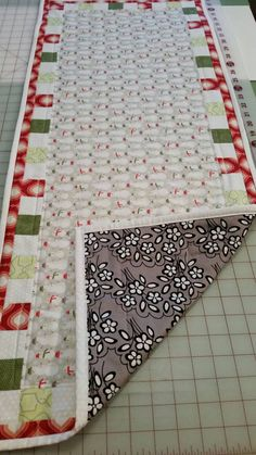 Check out this item in my Etsy shop https://www.etsy.com/listing/258848322/reversible-machine-quilted-table-runner