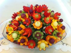 Colorful fruit bouquet arrangement by Najlaa Alsayegh who adapted the ideas taught in Nita's free radish bouquet lesson. You can get your free lesson at www.vegetablefruitcarving.com