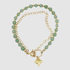 A Green Jade Bracelet with 24k gold plated goldfilled elements the fox charm is studded with white zircon the stones and beads are threaded on a heavy duty steel wire covered in nylon.