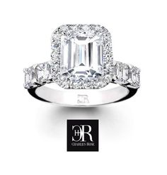 """Spectacular """"Sante"""", featuring perfectly matched and calibrated emerald cut diamonds, crowned with a large emerald cut surrounded by brilliants. All these premium grade gems are set into a fully hand made ring, exclusive to Charles Rose, Australia's finest diamond design house. #diamonds #love #jewellery"""