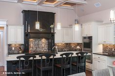 A gorgeous glass tile backspash anchors this kitchen, from the Sagecrest Plan 1226 http://www.dongardner.com/plan_details.aspx?pid=3676. #Glass #Backsplash #Kitchen