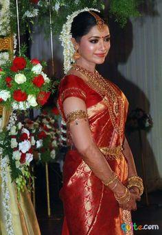 South Indian bride. Temple jewelry. Jhumkis.Red silk kanchipuram sari.Braid with fresh jasmine flowers. Tamil bride. Telugu bride. Kannada bride. Hindu bride. Malayalee bride.Kerala bride.South Indian wedding.Mamta Mohandas wedding.