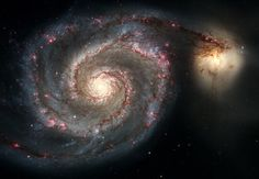 This Hubble image released in April 2005 shows the spiral galaxy M51, also known as the Whirlpool Galaxy, and its companion galaxy