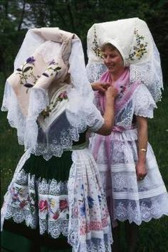 Europe | Portrait of two Sorbian girls wearing traditional clothes and headdress, Spreewald, Germany