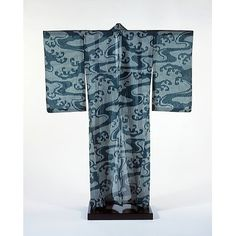 Kimono, 1930-1939 (made), Stencil-printed gauze weave silk. The bold visual rhythm of the cooling water motif is balanced by the delicacy of the gauze-weave fabric.the swirling water motif reflects the influence of Art Nouveau. Yet the design has its origins in the Japanese Rimpa style, particularly the work of the 18th-century artist Ogata Korin, which had itself played an important role in the evolution of Art Nouveau in the West.