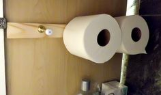 Space Saving Bathroom Ideas.Great solution for storing extra toilet paper when you don't have space. Door stoppers! They're long enough to hold a roll.