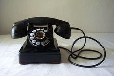 vintage art deco black telephone. $74.00, via Etsy.