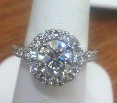 Brilliant cut in halo with diamonds down shank