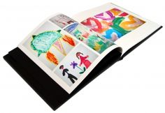 cofee table book made with pictures of childrens artwork