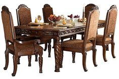 "The North Shore Extension Dining Table from Ashley Furniture HomeStore (AFHS.com). A deep rich stained finish and exquisite details come together to create the ultimate in grand traditional design with the elegance of the ""North Shore"" dining room collection."