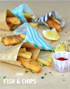 Mini fish & chips served in colourful paper party bags for a fun #kids #party food More