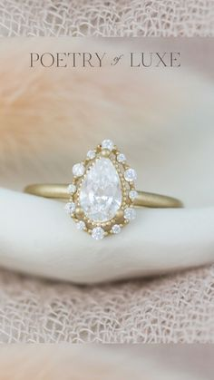 A unique pear shaped diamond engagement ring with a delicate diamond halo. - Poetry of Luxe Jewelry #daintyring #delicatering #pearshapeddiamond Vintage Inspired Engagement Rings, Unique Diamond Engagement Rings, Engagement Ring Styles, Pear Diamond, Pear Shaped Diamond, Halo Diamond, Delicate Rings, Dream Ring, Fashion Rings