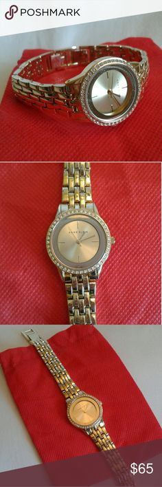 Anne Klein Gold Tone Bracelet Quartz Watch In good functioning condition. Water resistant 100ft, stainless steel back, AK 2294 - Y121E. Anne Klein Accessories Watches