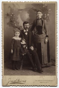 Victorian Family Photo, circa 1885 | A neat little picture showing the classic 1880s fashions from men, women, and girls (plus dolls!).