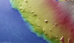 Colour-coded topographical map of the southeastern flank of the Olympus Mons volcano on Mars By europeanspaceagency