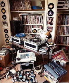 What I like about this picture is the way everything is shown. Like the CD's stuck on the wall and the music players on the table. Also with the collection of CD's in the shelf's.