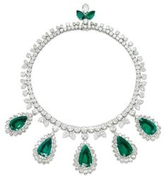 AN EXCEPTIONAL EMERALD AND DIAMOND NECKLACE, BY HARRY WINSTON.   Designed as a line of graduated brilliant-cut diamonds, with twin pear-shaped diamond detail, suspending five detachable pear-shaped emerald and diamond pendants, to the marquise-shaped diamond and pear-shaped emerald pendant clasp, mounted in platinum.