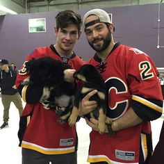 Calgary Flames: Sean Monahan and Brandon Bollig with two puppies