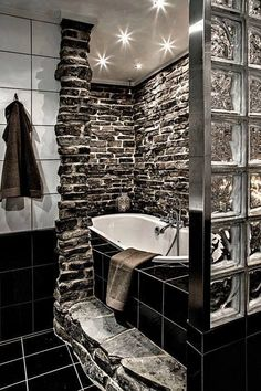 Trendy #bathroom design, and the perfect bathtub to unwind your day. The sleek #plumbing fixtures also add personality to this remodel. www.PlumbingPlus.net